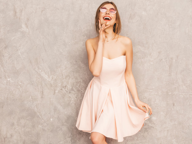 portrait-young-beautiful-smiling-girl-trendy-summer-light-pink-dress-sexy-carefree-woman-posing-positive-model-having-fun-dancing-round-sunglasses_158538-5153